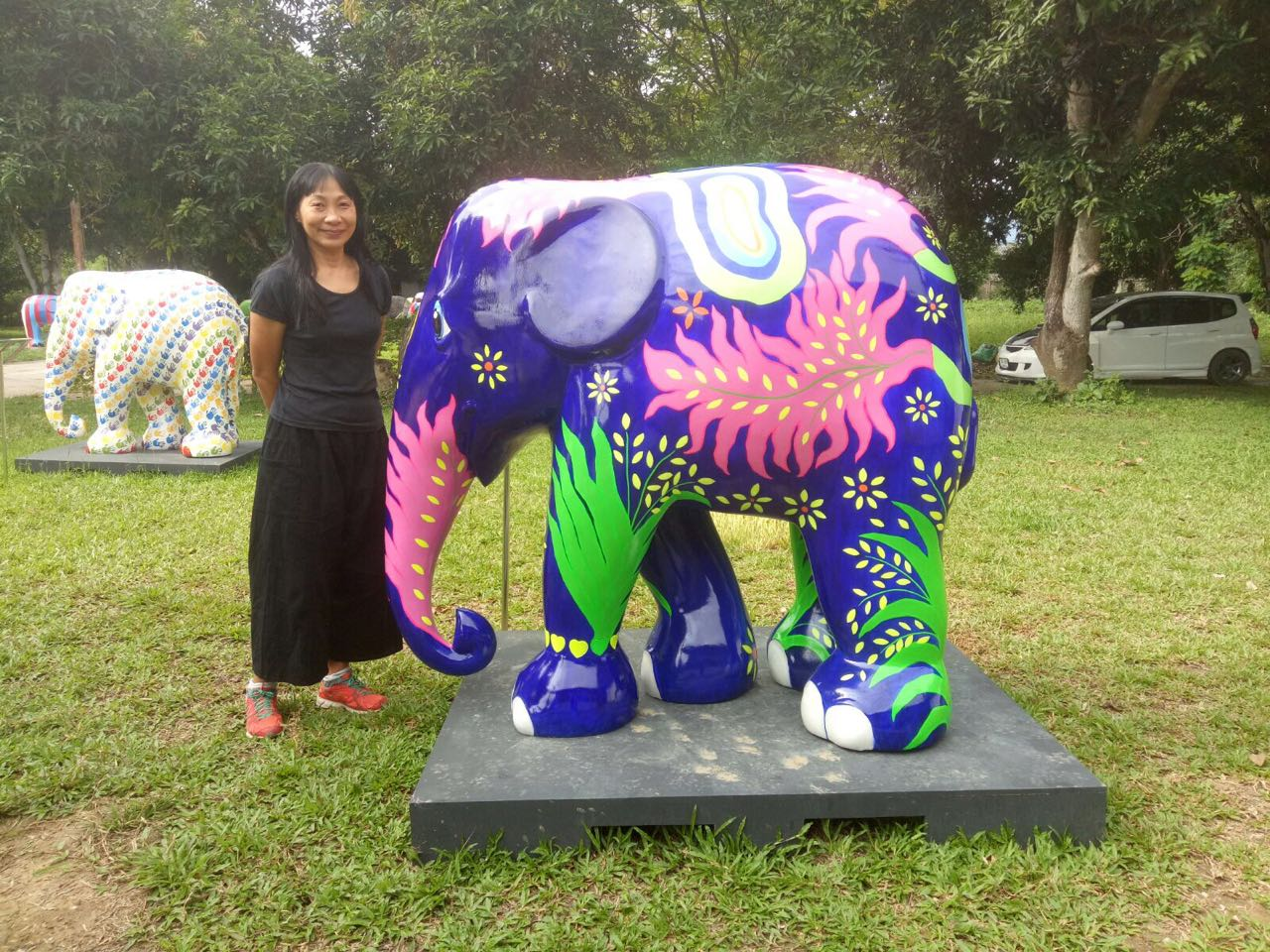Artist Li Li Tan with her painted elephant statue for Elephant Parade
